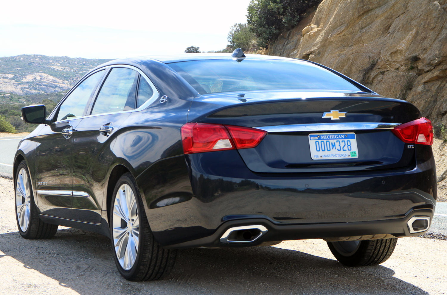 First drive 2014 chevrolet impala digital trends 2014 chevrolet impala navy rear left angle voltagebd Image collections