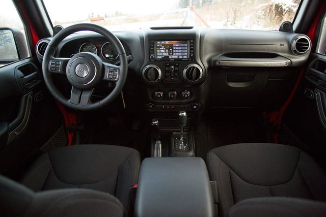 2014 Jeep Wrangler Unlimited Sport interior front rear view