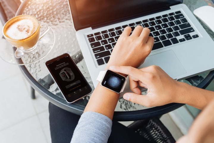 how to pair an apple watch 69128377  woman using smart in coffee shop modern city lifestyle