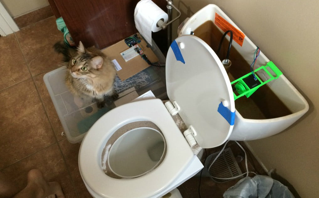 This couple created an automatic flusher for their toilet