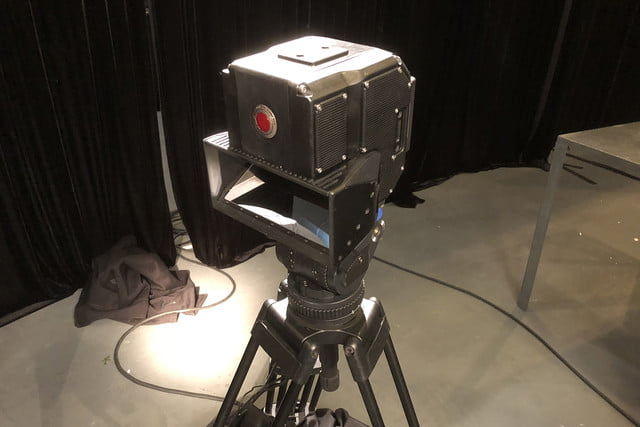red lucid 4v holographic camera coming 3d on stand  2