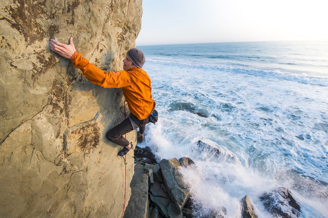 to get perfect mountain shot corey rich climbs mountains a man at mickey s beach in stinson  calif