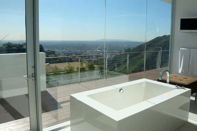 homes with their own shark tanks hollywood hills sharks 17