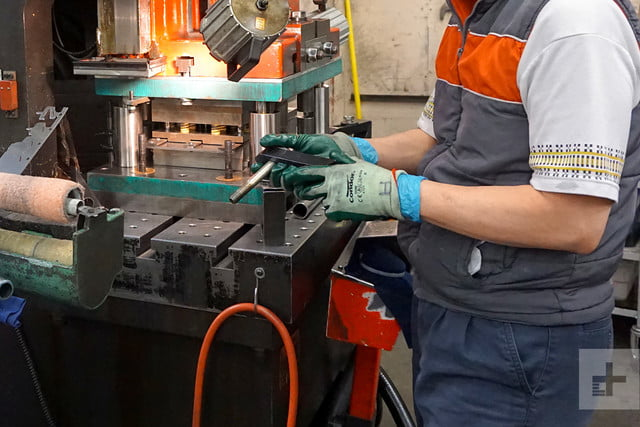 MSR factory tour worker with gloves