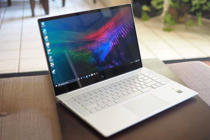 HP Envy 15 with color display on a surface to compare Dell vs.  HP