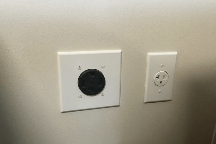An electric and gas dryer outlet, on the left and right, respectively.