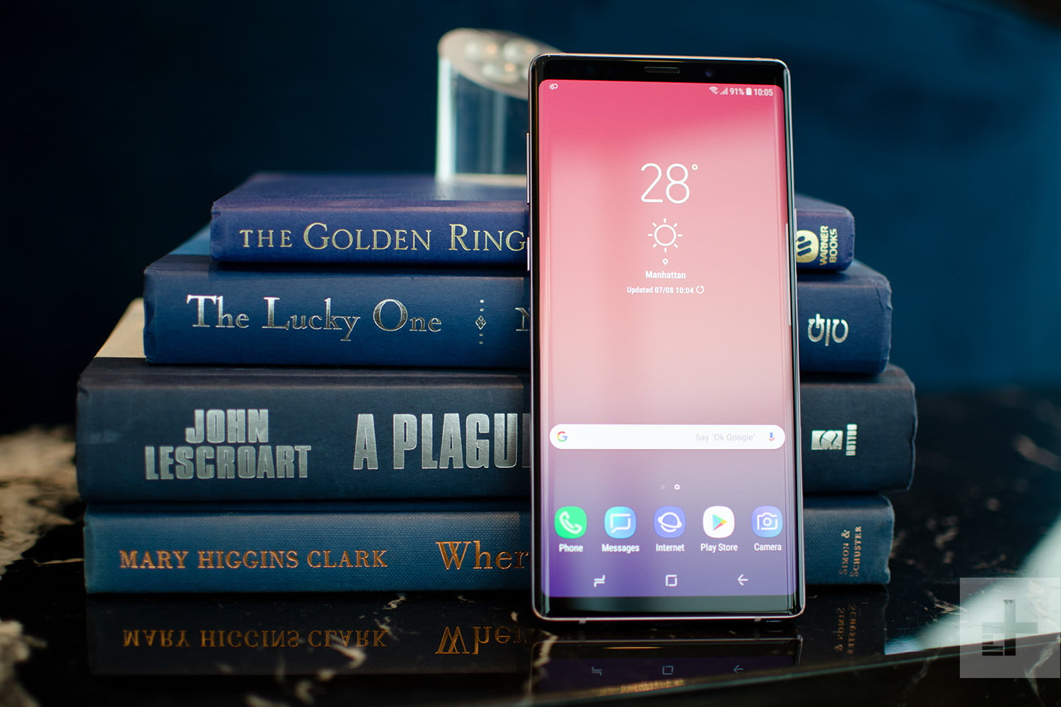 Galaxy Note 9 front against books