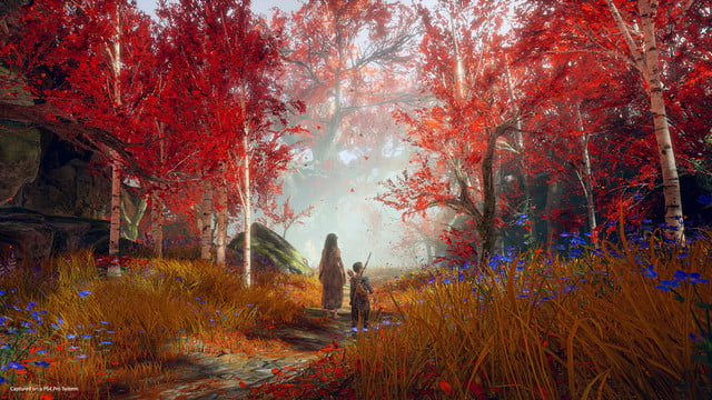 God of War Review | Atreus walking through a beautiful autumn forest with an unknown worman