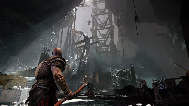 God of War Review | Kratos looks up at a large wooden structure