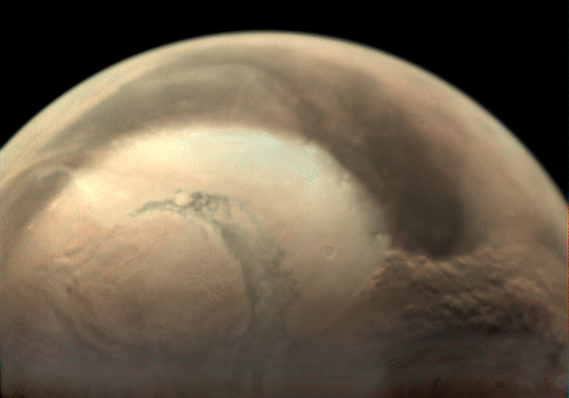 See a gargantuan dust storm covering the north pole of Mars