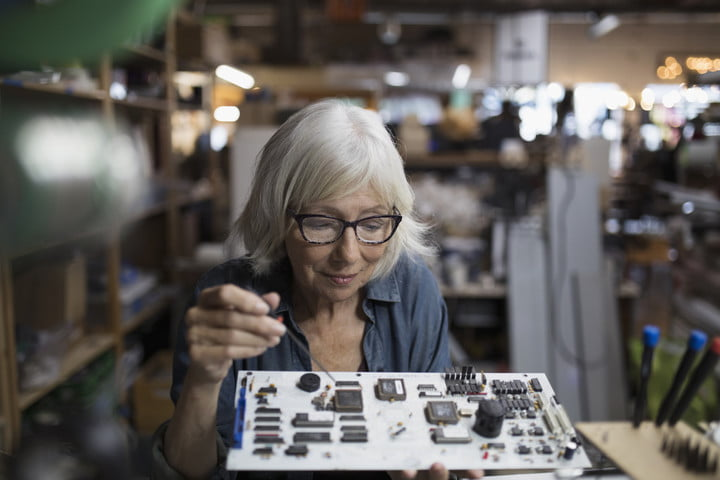 kickstarter hardware studio connection senior female engineer assembling electronics circuit board in workshop
