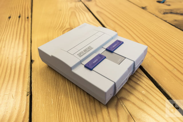 The SNES Classic Edition angled downward right and facing the camera