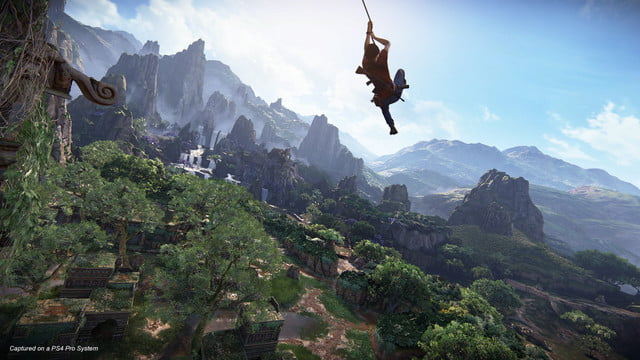 Uncharted: The Lost Legacy Chloe swinging on a rope over a large cliff